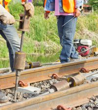 Men Working On Rail Tracks
