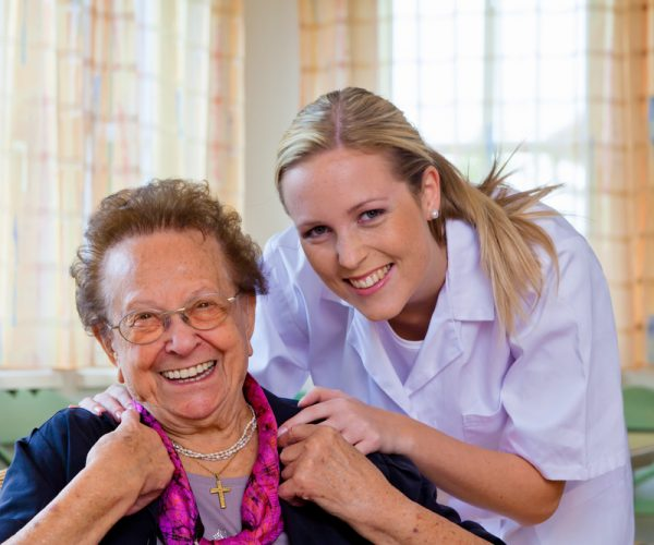 Smiling Health Care Professional with Lady