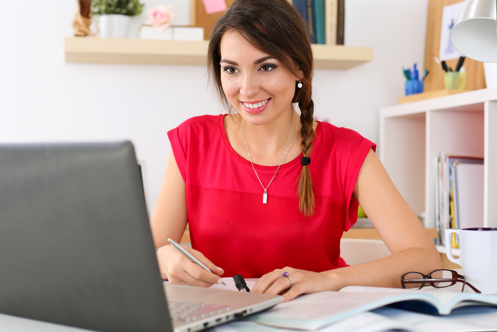 Smiling Lady Working Online