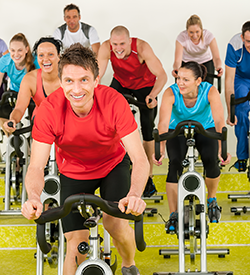 Fitness Instructor and class on bikes